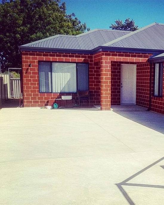 Perth home with liquid limestone concrete drive